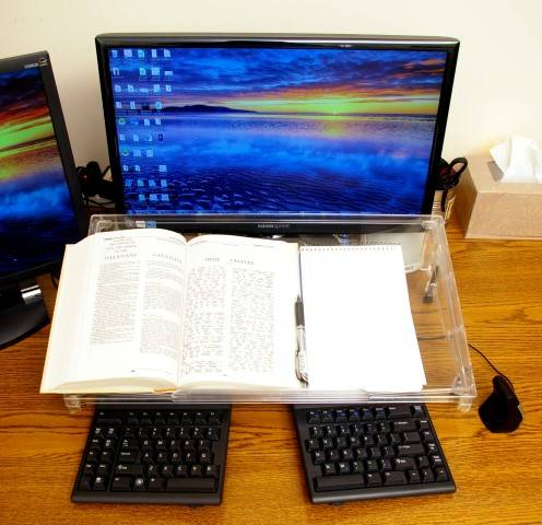 The full-size Microdesk bridges the space between keyboard and monitor, and is wide enough to let the keyboard slide partly under it.