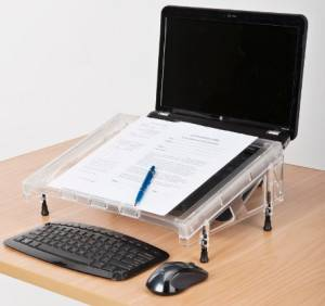 The Compact Microdesk, shown in this stock photo with a laptop and stand configuration.