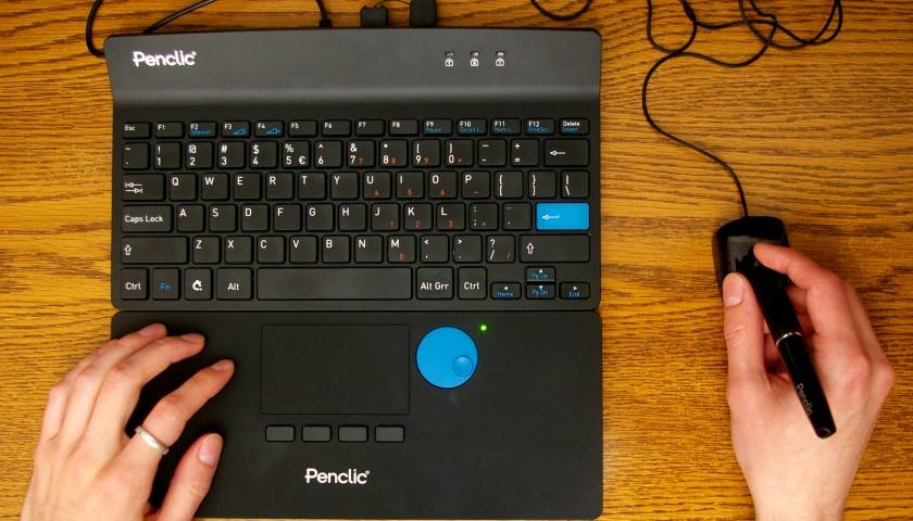 In this two-handed setup, the right hand works the Penclic while the left clicks and scrolls with the NiceTouch